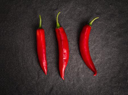 red chilli pepper plant: the chili pepper on black stone background