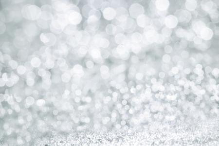 The Abstract bokeh lighting background , silver color tone Archivio Fotografico