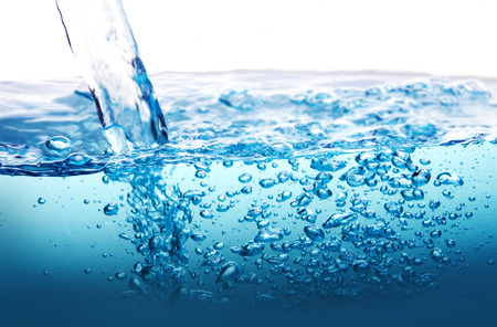 the Close up blue Water splash with bubbles on white background