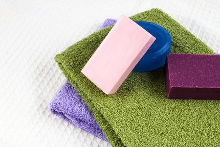 natural soap: the natural soap bar on bath towel Stock Photo
