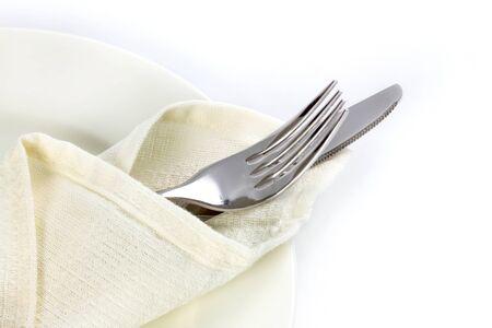 銀製フォークおよびナイフで白い背景とテキスト領域に料理をダイニングでふさげ 写真素材