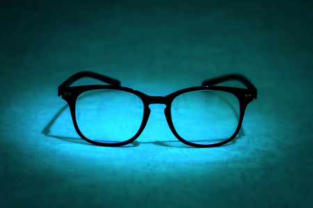 diopter: still life with the reading eyeglasses on blue background