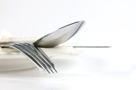 close up dinning the silverware fork , spoon and knife with dish on white background and text space Banque d'images