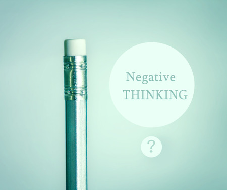 negative thinking: close up eraser on top silver pencil on the  blue gray gradient background with negative thinking concept