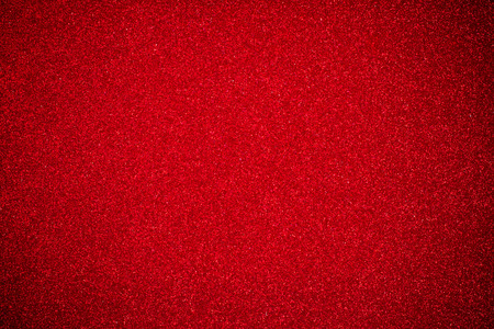 close up the red glitter paper background