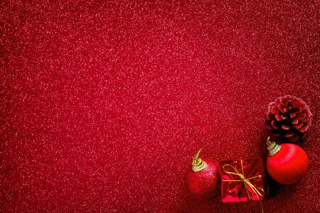 red christmas ball: red christmas ball and gift decoration on the glitter background Stock Photo