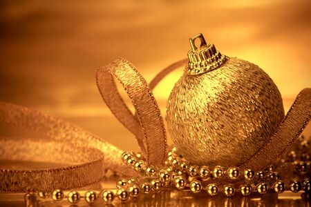 christmas balls: the golden christmas ball decorations for celebration background