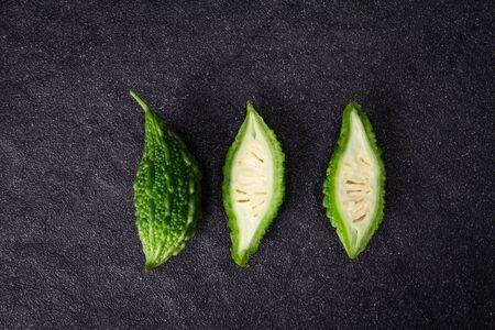 the Balsam Pear on black stone plate background 免版税图像