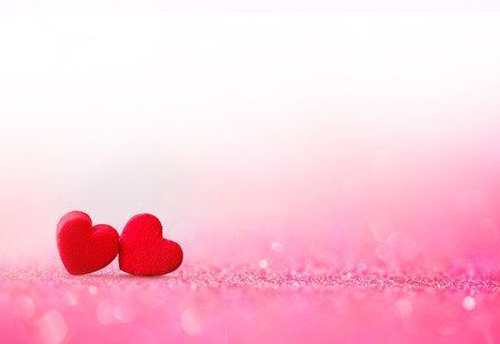 The red Heart shapes on abstract light glitter background in love concept for valentines day with sweet and romantic moment Archivio Fotografico