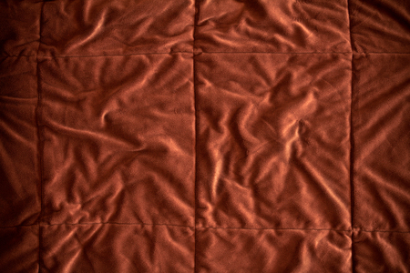smut: the close up  on Crumpled golden brown fur fabric Stock Photo