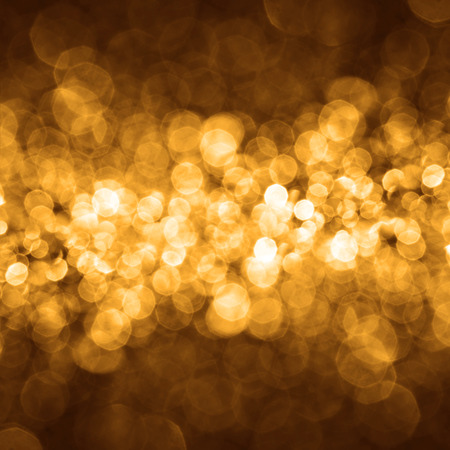 holiday lighting: the Abstract elegant gold bokeh lighting for christmas or holiday background