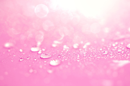 Close up the rain water drops on pink sponge surface as lve romance abstract background