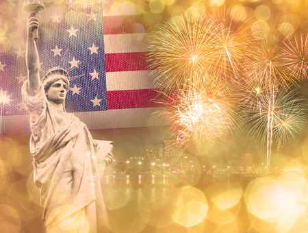 The Statue of Liberty with celebration firework on the background of flag usa, 4th July Independence day concept