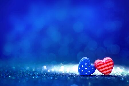 The American flag Heart shapes on abstract light glitter background ,concept for 4th July Independence day
