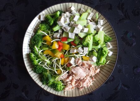 the healthy food salad mixed of tuna and vegetable on dark fabric background Stock fotó