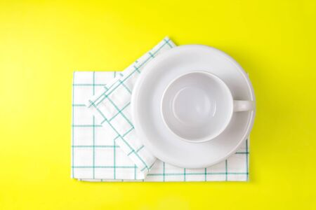 the top view of empty white coffee or tea cup with towel on vibrant color background Stock Photo