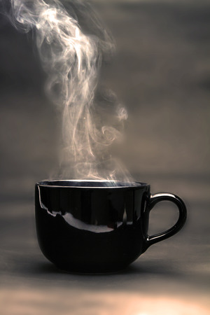 the warm black cup of coffee Stock Photo