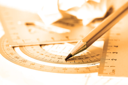 selective focus of  the pencil with precision measurement tool , golden color tone Stock Photo