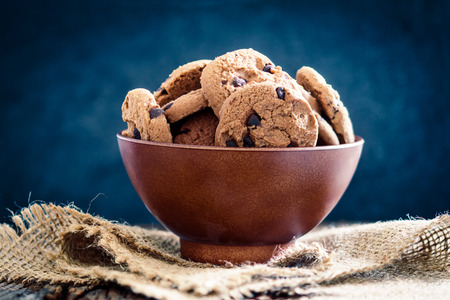 Still life of Close up  chocolate chip cookies in cup bowl on  napkin with rustic background Zdjęcie Seryjne - 65396911