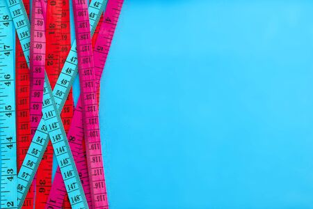Diet control concept background. Colorful of Measuring tape on vibrant color  background.