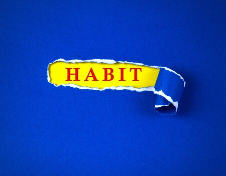 Torn blue Paper and space for habit text with a  yellow paper background , change habit concept Banco de Imagens