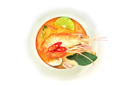 Close up Asian Spicy soup with shrimp in white bowl , famous Thai food cuisine calling Tom Yum Kung  Stock Photo