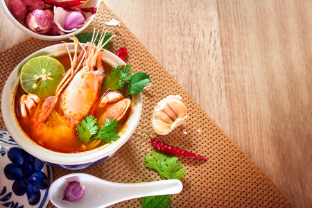 Close up Asian Spicy soup with shrimp in  bowl , famous Thai food cuisine calling Tom Yum Kung