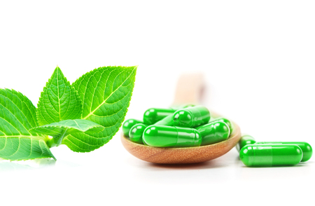 organic herbal green medicine capsule ,alternative drug concept Stock Photo
