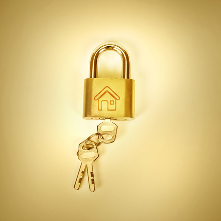 the Metalic padlock on yellow background ,golden color tone