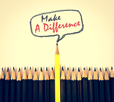 difference: the yellow wooden pencil arrange  with make a difference concept