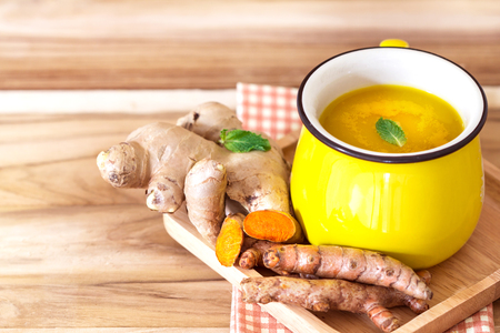 cup of Turmeric Tea with lemon and ginger , Benefits for reduce Inflammation , Liver Detox and Cleanser healthy herb drink concept Zdjęcie Seryjne - 76691545