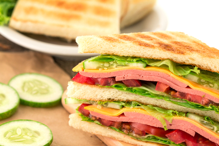 the Sliced Grilled sandwiches bread with bacon , ham and cheese with vegetable , healthy breakfast Stock Photo