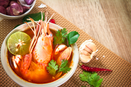 Closeup Asian Spicy soup with shrimp in  bowl , famous Thai food cuisine calling Tom Yum Kung
