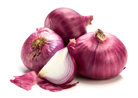 Fresh red onion sliced bulb and onion peel isolated on white background