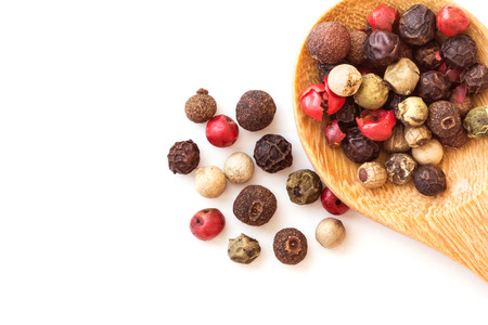 peppercorn: Close up mixed type of peppercorns in wooden spoon , top view or overhead shot