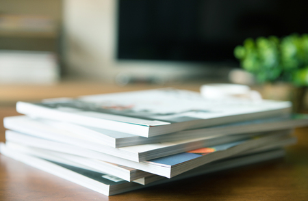 selective focus of the stacking magazine place on table in living room Zdjęcie Seryjne - 80738237