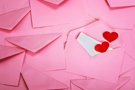 close up Stacking of pink envelopes and mail letter paper and red herat , romance  love letter concept for holiday valentines day greeting card concept Foto de archivo