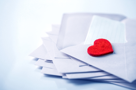 close up Stacking of white envelopes and mail letter paper and the red herat , romance  love letter concept for holiday valentines day greeting card concept , cool color tone Standard-Bild