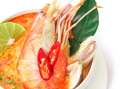 Close up Asian Spicy soup with shrimp in white bowl , famous Thai food cuisine calling Tom Yum Kung