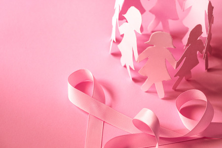 Sweet pink ribbon shape with girl paper doll on pink background  for Breast Cancer Awareness symbol to promote  in october month campaign