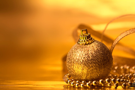 the golden christmas ball decorations for celebration background
