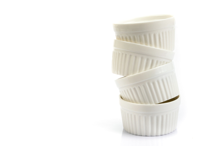 stacking of small white bakery cup on white background Stock Photo