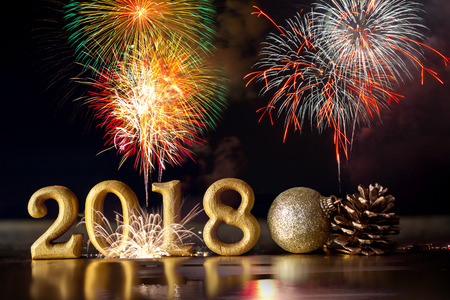 Golden Number 2018 placed on dark elegant glamour night tone background with celebration firework for happy new year and merry christmas 2018  concept