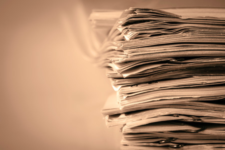 white sheet: extreamely close up  report paper stacking of office working document , retro color tone