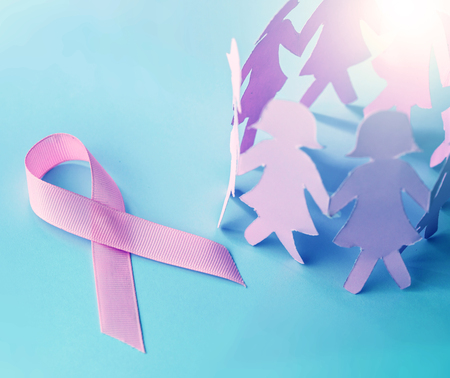 Sweet pink ribbon shape with girl paper doll on blue background  for Breast Cancer Awareness symbol to promote  in october month campaign Stock Photo