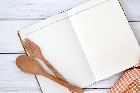 blank page of book notepad paper opened and tablecloth on white table , recipes food  for healthy habits shot note background concept