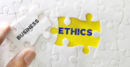 Close up piece of white jigsaw puzzle with word of Business Ethics , concept of a business core value and moral 스톡 콘텐츠