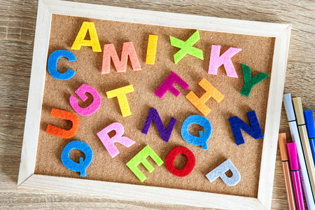 colorful ENGLISH  alphabet on pin board background ,English language learning concept