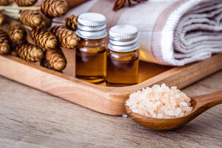 Close up brown organic Himalayan rock salt spa and cinnamon essential oil aroma set on the table , healthy spa relaxation concept