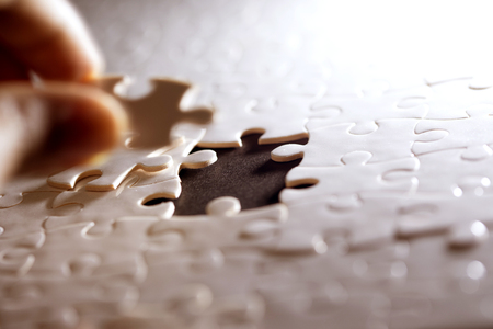 Close up piece of white jigsaw puzzle , concept of business challenge completion with teamwork Standard-Bild - 116493198